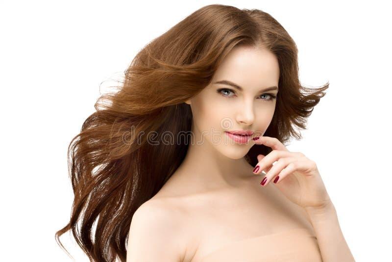 秀丽女孩接触她的面孔 有发光的卷的美丽的少妇 库存图片