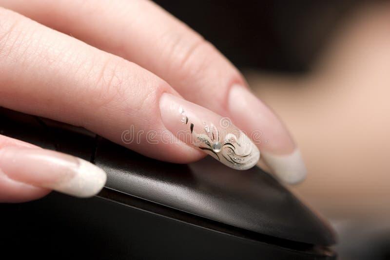 秀丽手指鼠标钉子 图库摄影