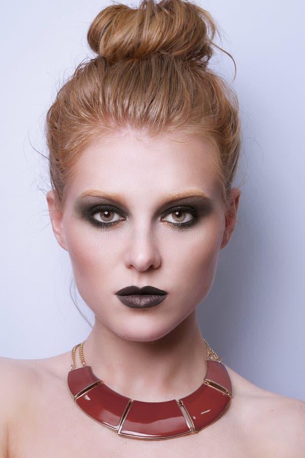 秀丽时装模特儿妇女面孔 库存图片
