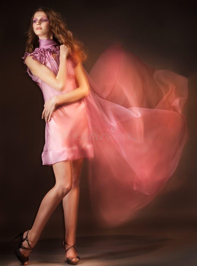 秀丽礼服粉红色妇女 免版税库存图片