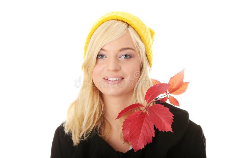 秋天青少年的妇女 免版税图库摄影