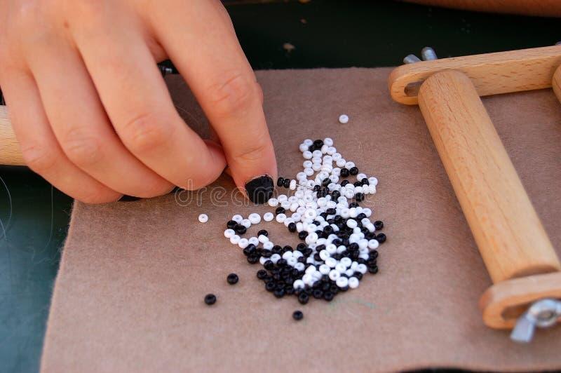 种子小珠和织布机 库存图片