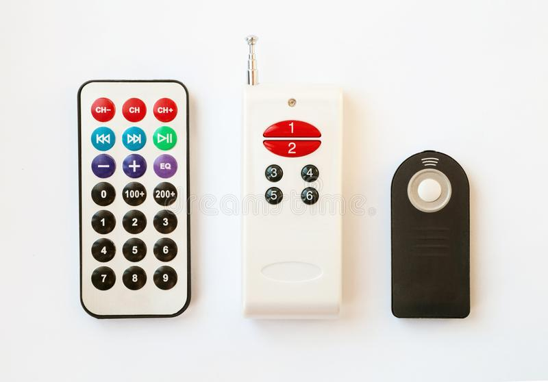 3种类型的遥控与按钮的各种各样的数字 库存图片