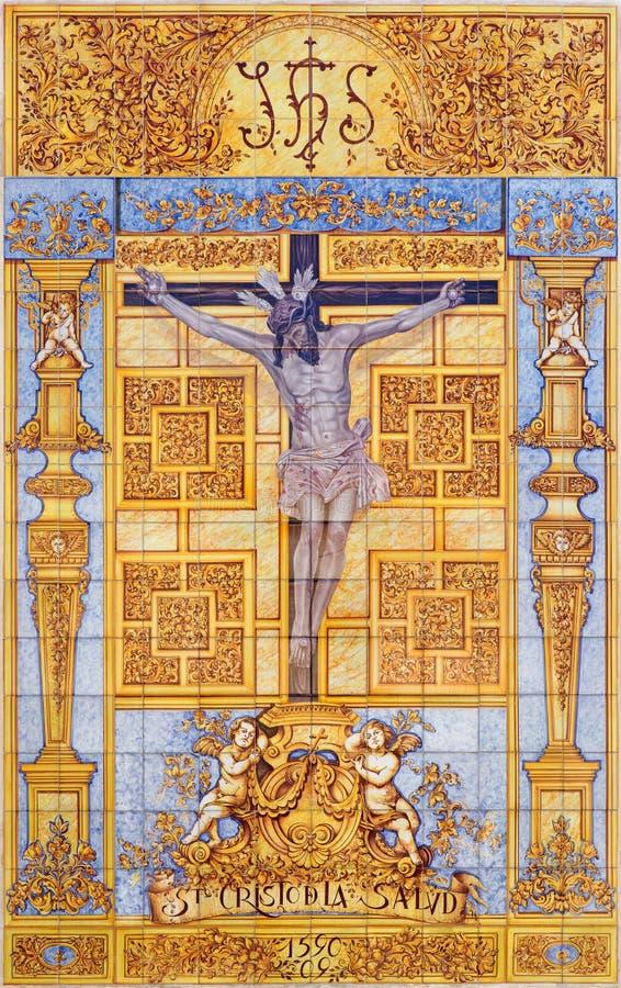 科多巴-由artis M的铺磁砖的在十字架上钉死 从20的Tienda 分 在教会Iglesia de圣尼古拉斯de la Villa门面  库存图片