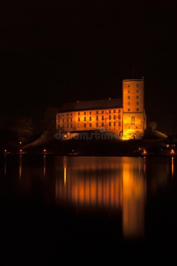 科灵城堡在晚上 库存照片