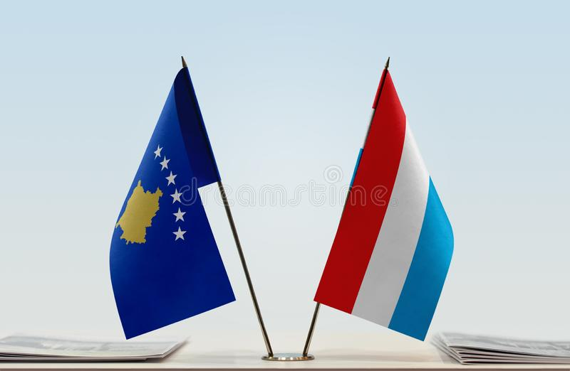 科索沃和卢森堡的旗子 图库摄影