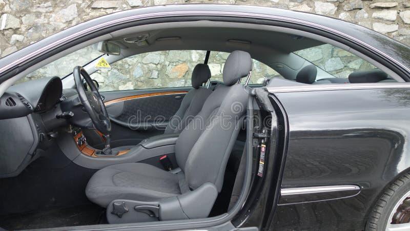 科鲁Napoca/罗马尼亚- 2016年9月19日:奔驰车W209-年2005年,高雅设备,黑金属油漆,照相讲席会C 图库摄影