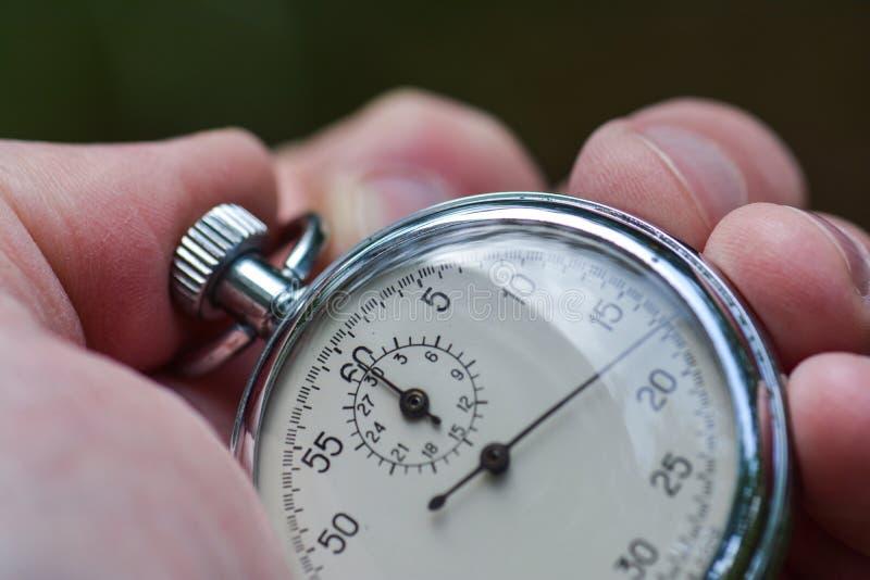 秒表在手中 免版税库存图片