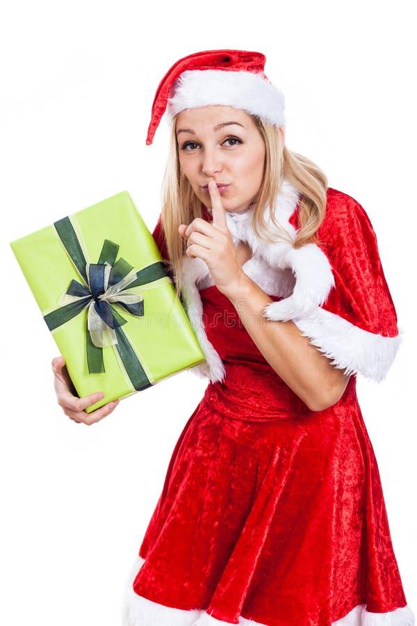秘密圣诞节妇女 免版税图库摄影