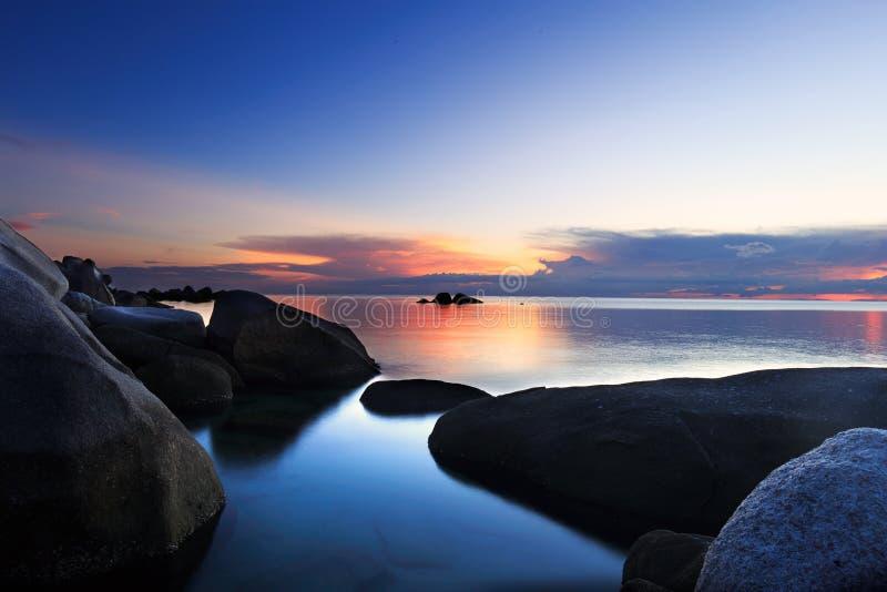 秘密海滩日落 免版税库存照片