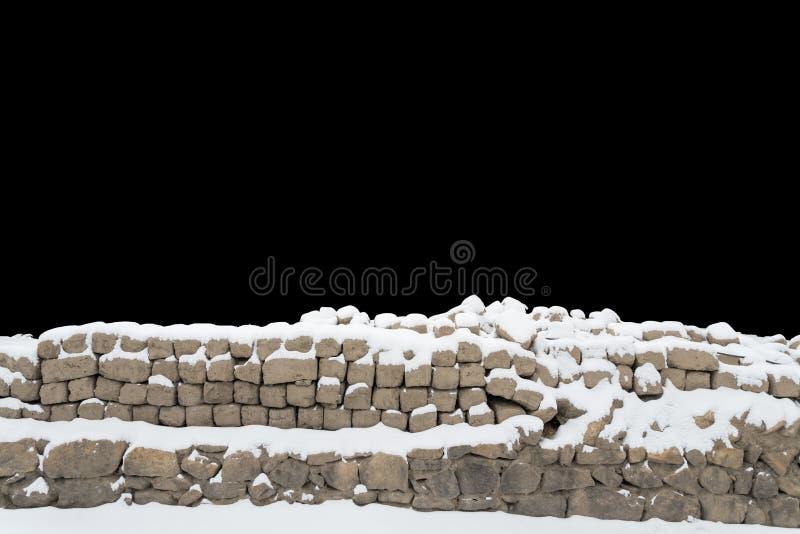 积雪的石墙 库存照片