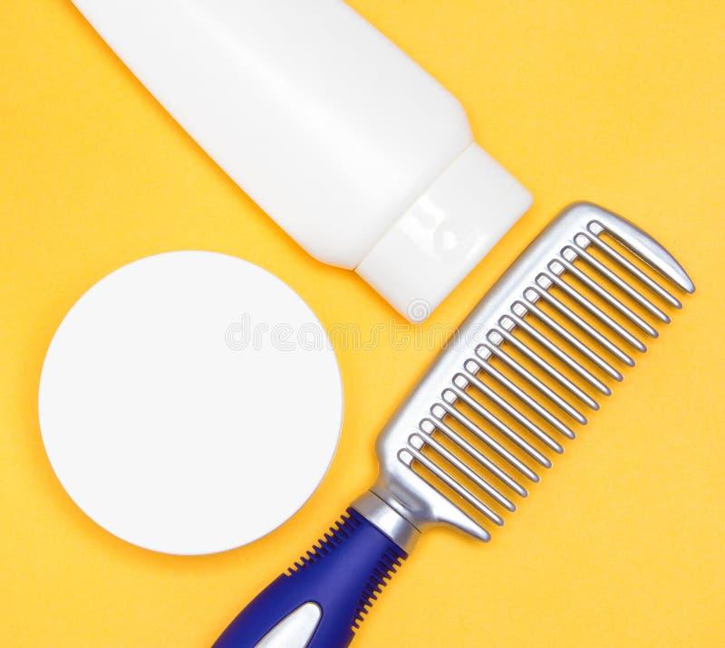 称呼与梳子的头发产品 免版税库存图片
