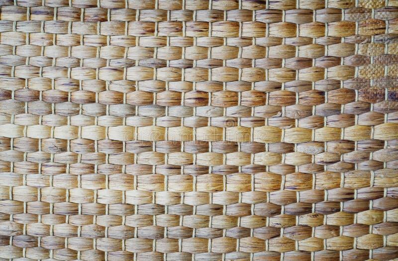 秸杆方平组织背景,草纹理从自然海草垫席纺织法 库存照片