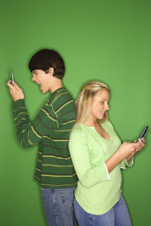 移动电话十几岁 免版税图库摄影