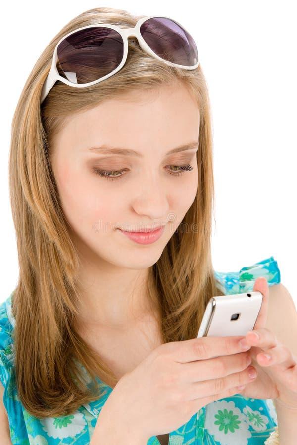 移动电话夏天少年妇女 库存图片