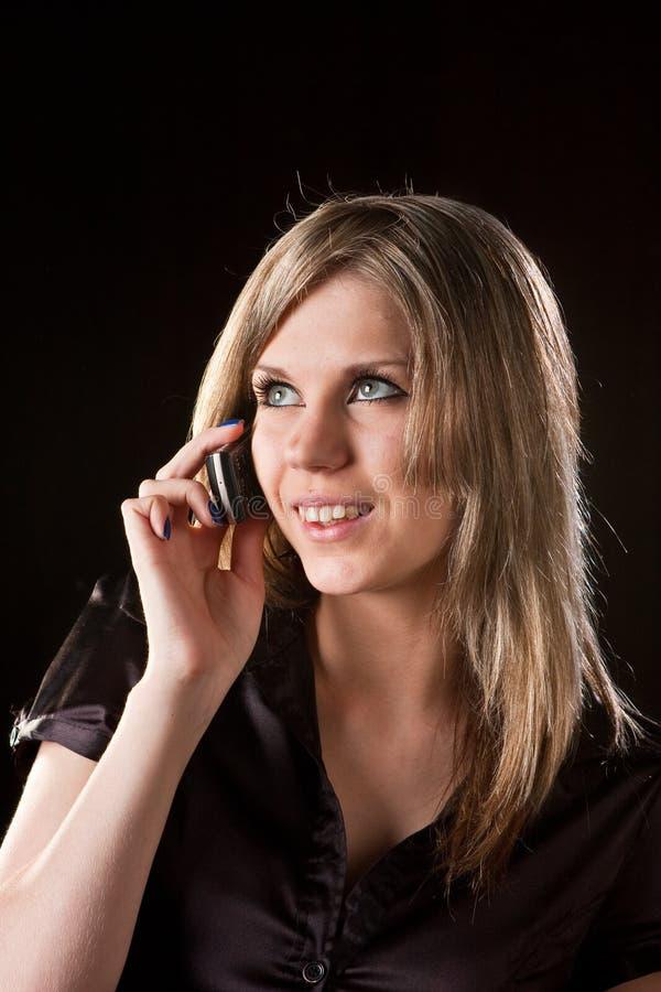 移动电话女孩告诉 图库摄影