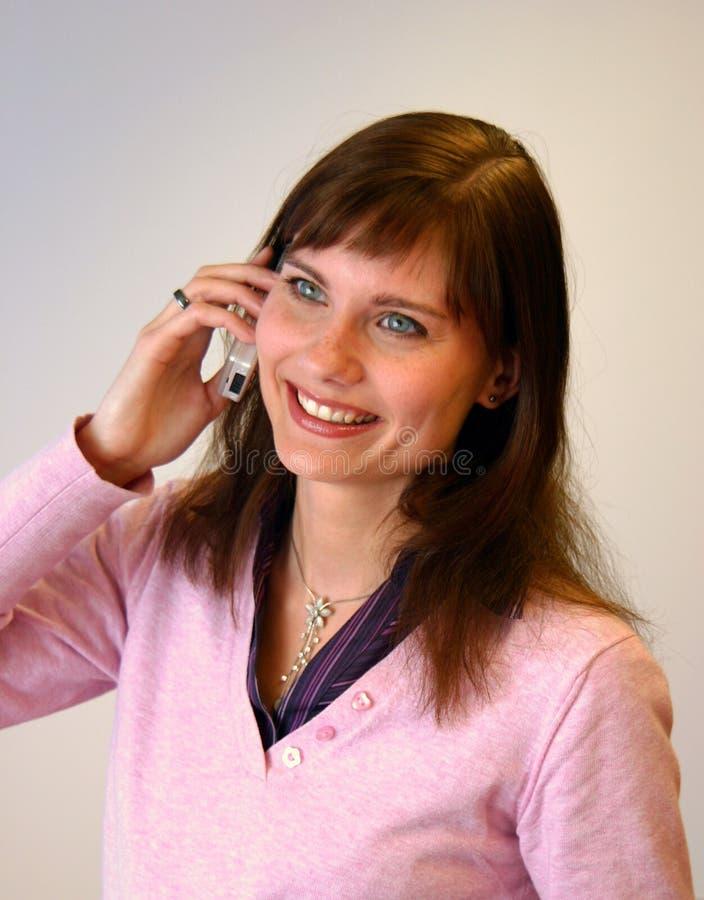 移动电话女孩她联系 免版税库存图片