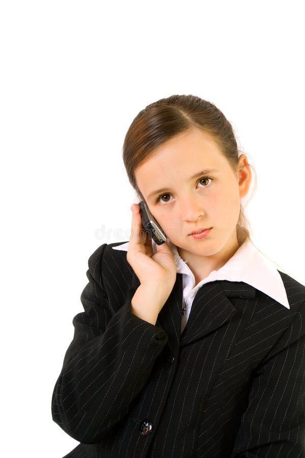 移动电话女小学生 免版税库存照片