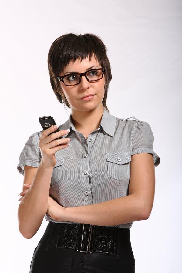 移动电话妇女年轻人 免版税库存图片