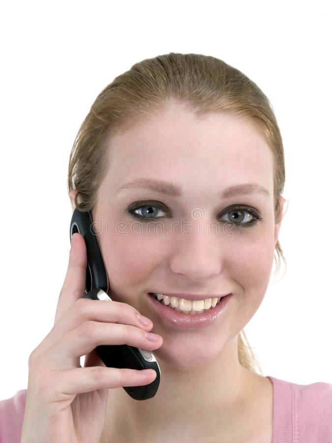 移动电话微笑的妇女年轻人 免版税库存照片