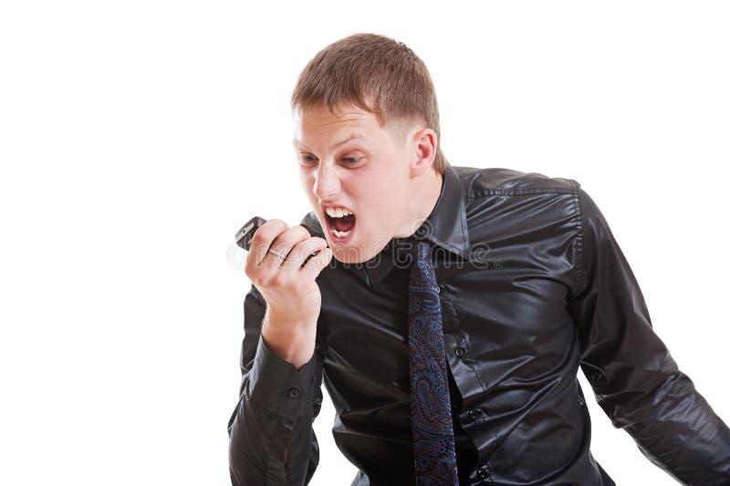 移动电话被激怒的人 免版税库存照片