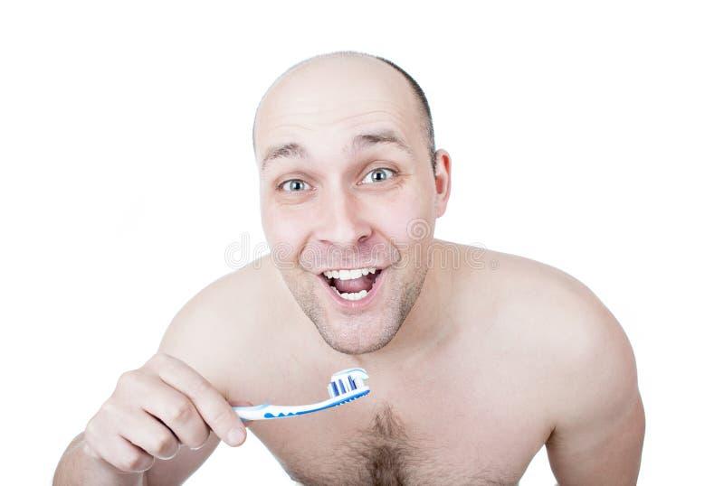 滑稽的人洗涤的牙 免版税库存图片