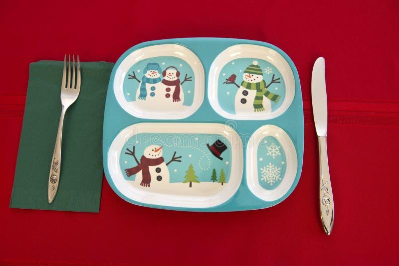 滑稽的假日儿童圣诞节表餐位餐具 库存图片