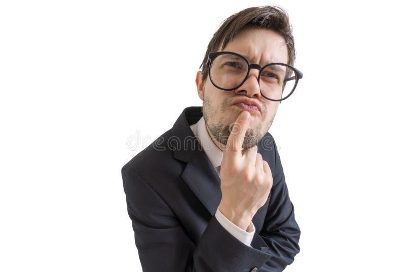 滑稽的可疑或迷茫的商人看您 背景查出的白色 免版税图库摄影