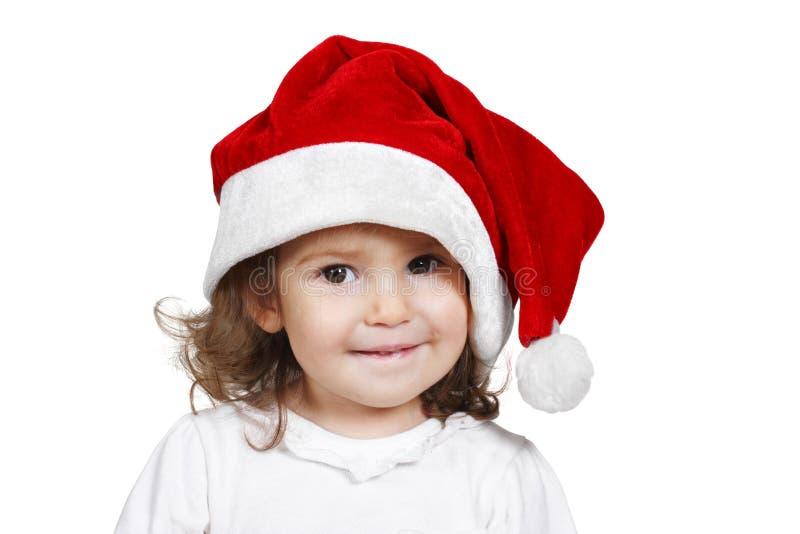 滑稽的孩子穿戴了圣诞老人帽子,隔绝在白色 免版税库存照片