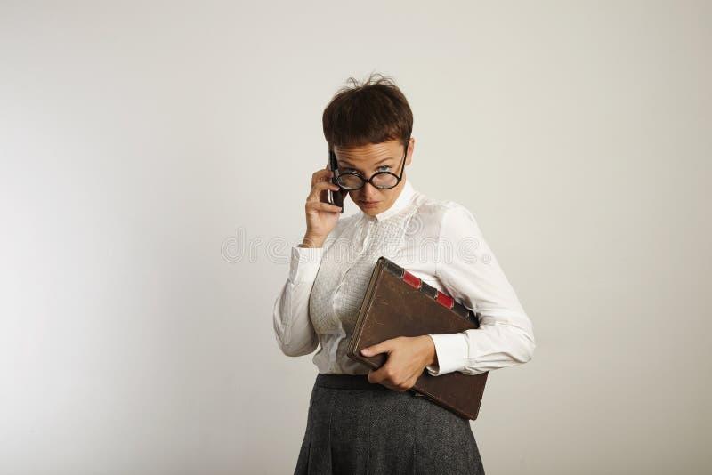 滑稽的老师发表演讲关于手机 库存图片