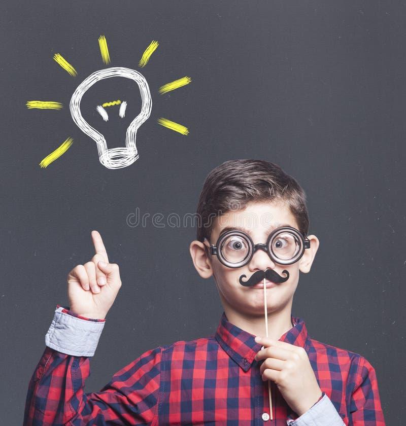 滑稽的聪明的孩子 免版税库存照片