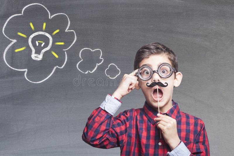 滑稽的聪明的孩子 库存照片