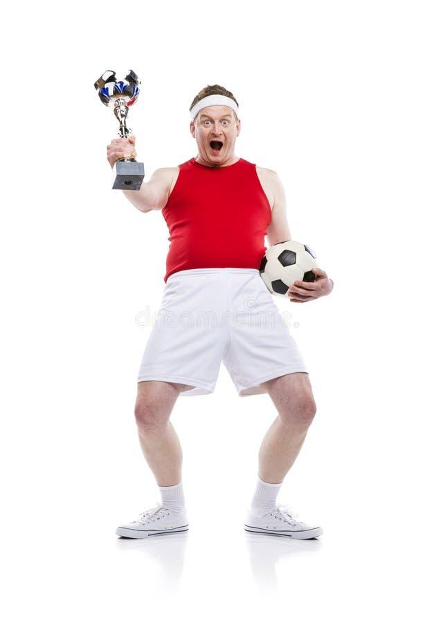 滑稽的足球运动员 免版税库存照片
