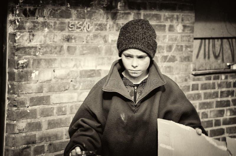 贫穷的男孩 图库摄影