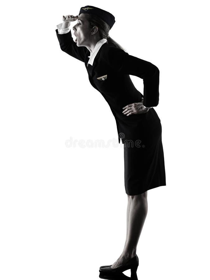 空中小姐客舱看惊奇的被隔绝的silh的乘员组妇女 免版税库存图片