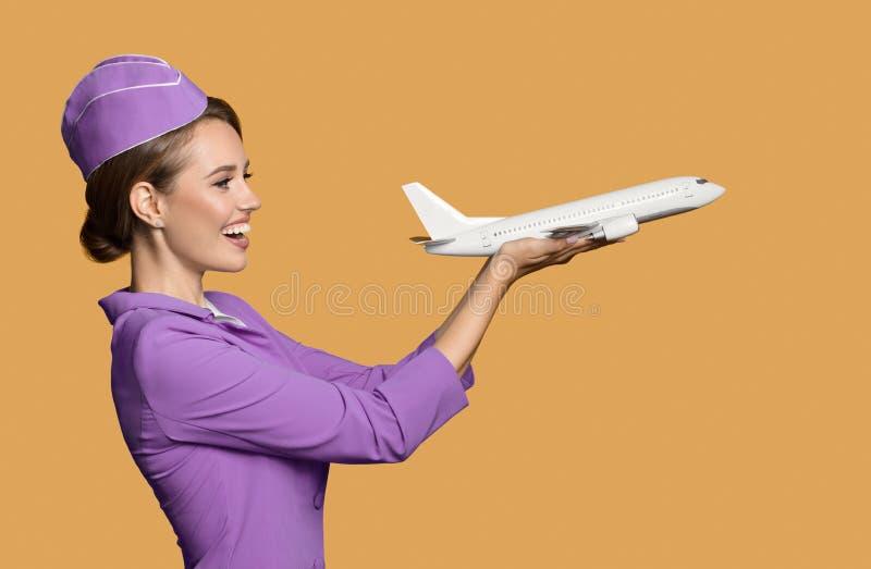 空中小姐藏品飞机在手中 库存照片