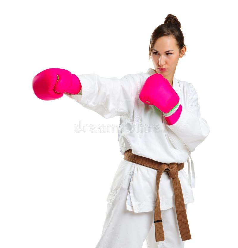 空手道姿势的一个女孩 在桃红色手套 背景查出的白色 库存图片