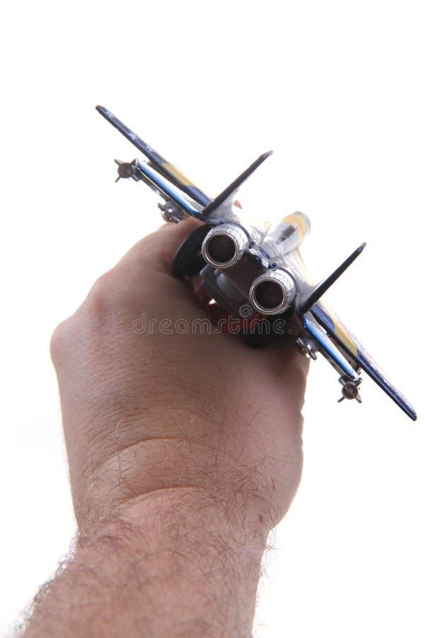 空气在人头的战斗机玩具 库存照片