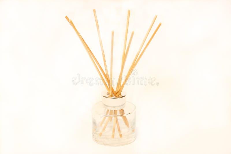 空气清凉饮料瓶和木棍子被隔绝在白色背景 免版税库存照片