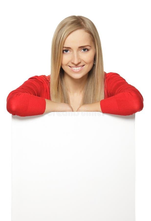 空白倾斜的whiteboard妇女 免版税库存图片