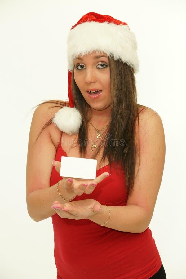 空白女孩显示符号的圣诞老人 免版税图库摄影
