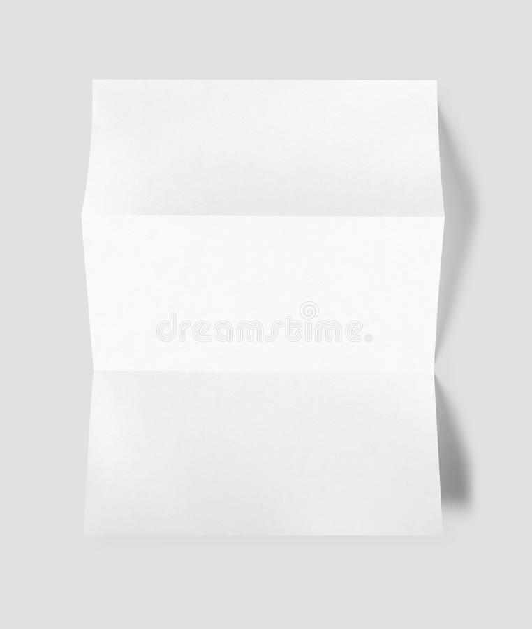 空白折叠了白色A4纸板料大模型模板 免版税库存图片