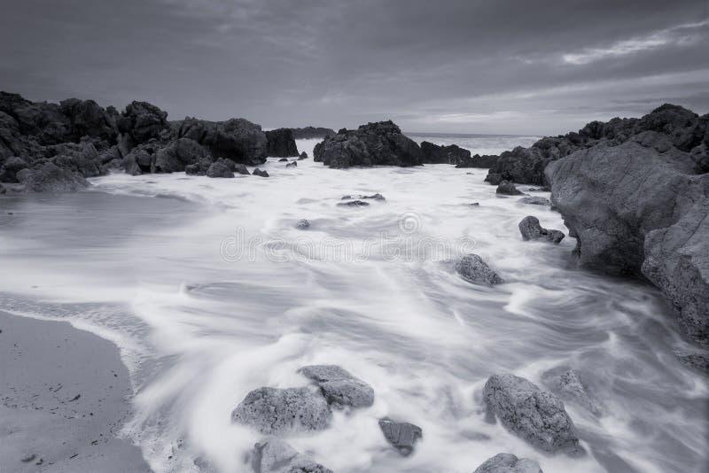空白海滩黑色的liencres 免版税库存照片
