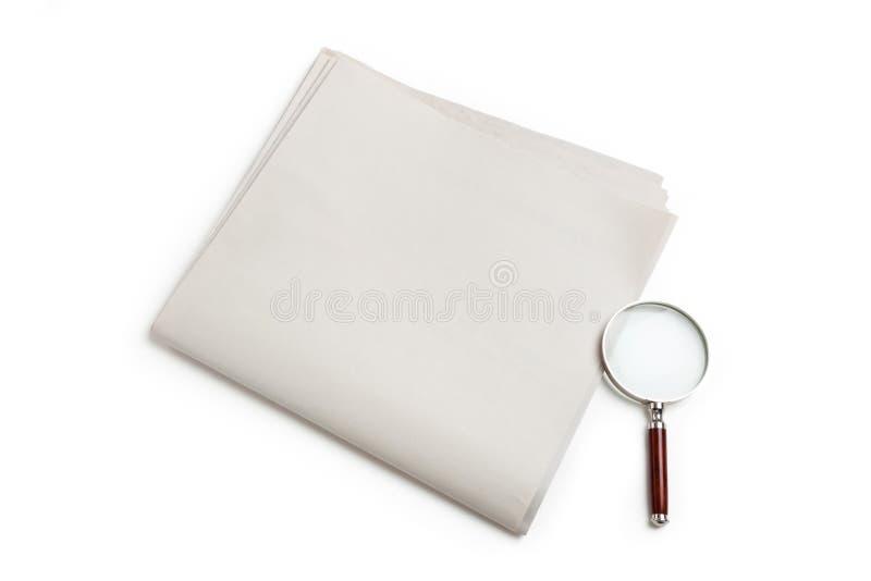 空白玻璃扩大化的报纸 免版税库存照片