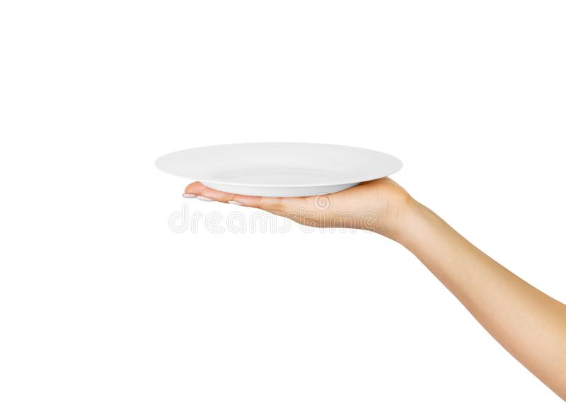 空白的空的圆的板材在女性手上 透视图,隔绝在白色背景 库存图片
