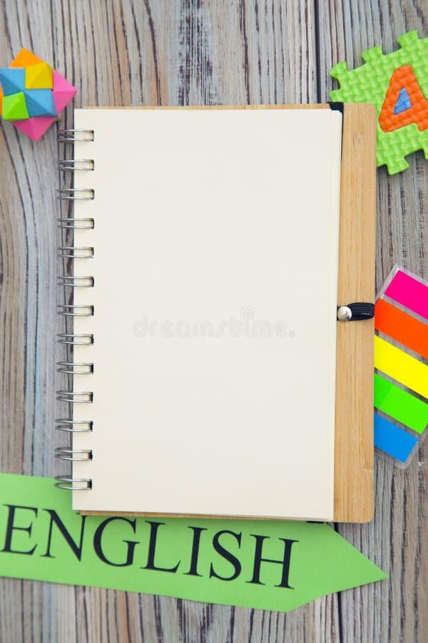 空白的笔记本和英国题字 免版税库存照片