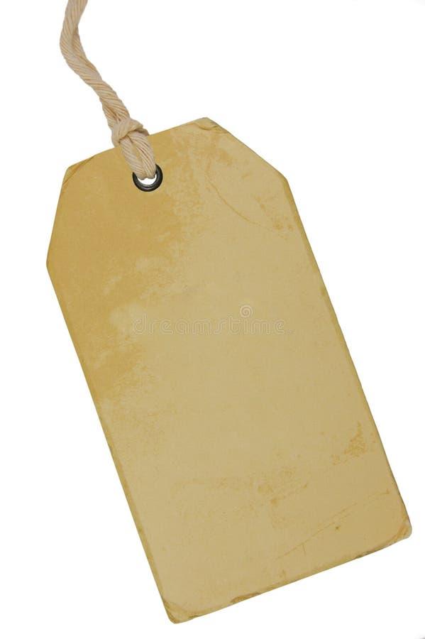 空白的米黄葡萄酒纸板销售标记,空的难看的东西价格标签Pricetag徽章,被隔绝的脏的宏观特写镜头垂直的拷贝空间 免版税图库摄影