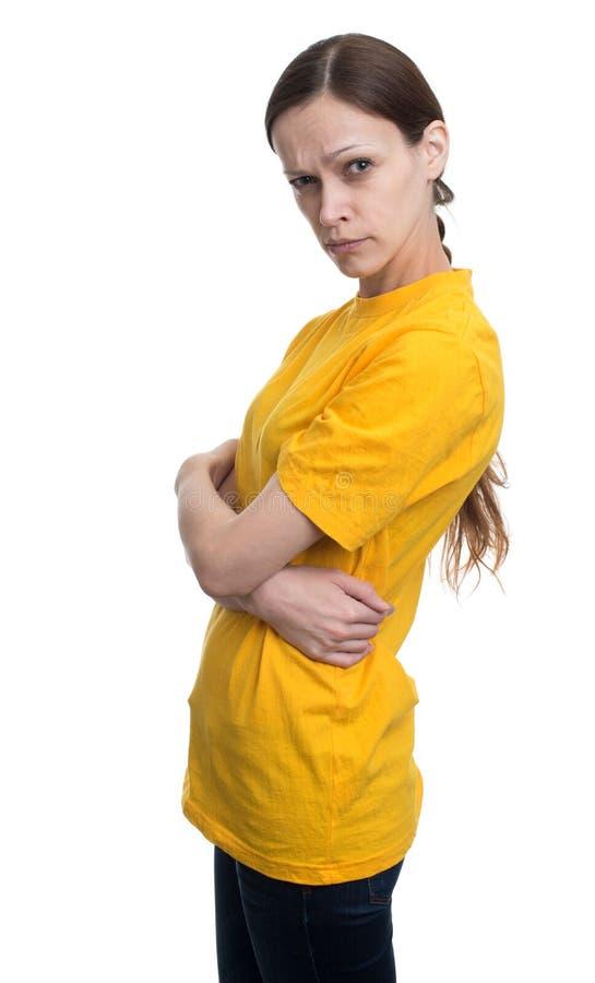 空白的黄色T恤杉的少妇 免版税库存图片