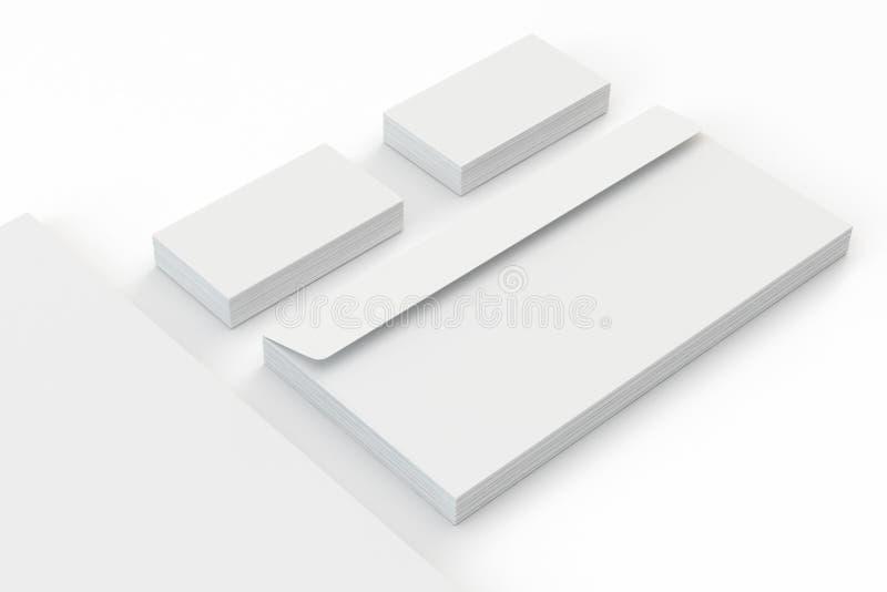 空白的A4纸,名片,在白色隔绝的信封 免版税库存图片