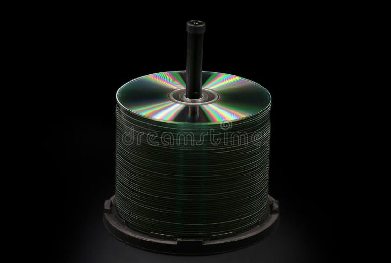 空白的DVD,在黑色隔绝的CD的圆盘 库存图片